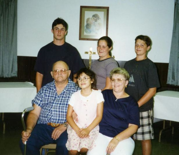A photo of my grandfather, grandmother, and the other grandchildren taken when I was about six years old