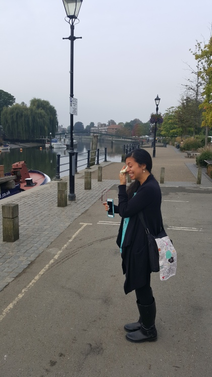 Beckie stands on the edge of the river Thames in Twickenham and weeps. She is holding a