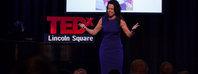 Kristin on the TEDx stage. Photo from her website KristinSmedley.com/
