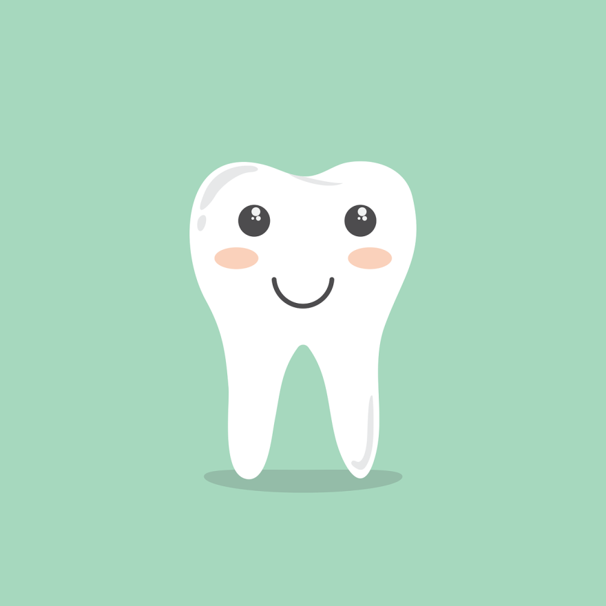 A cartoon tooth smiles pleasantly on a green background