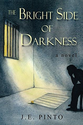 Image shows the cover of the The Bright Side of Darkness by J.E. Pinto.The cover shows a figure in silhouette sitting with their head in their hands inside a room with a barred window.