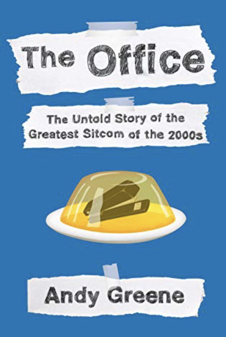 The cover of the book is blue and shows a stapler in encased a Jell-O mold