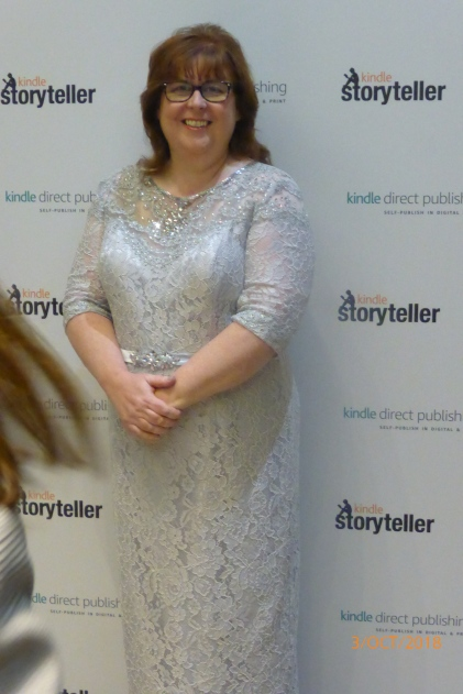 The author stands in a sparkling dress at the Amazon
