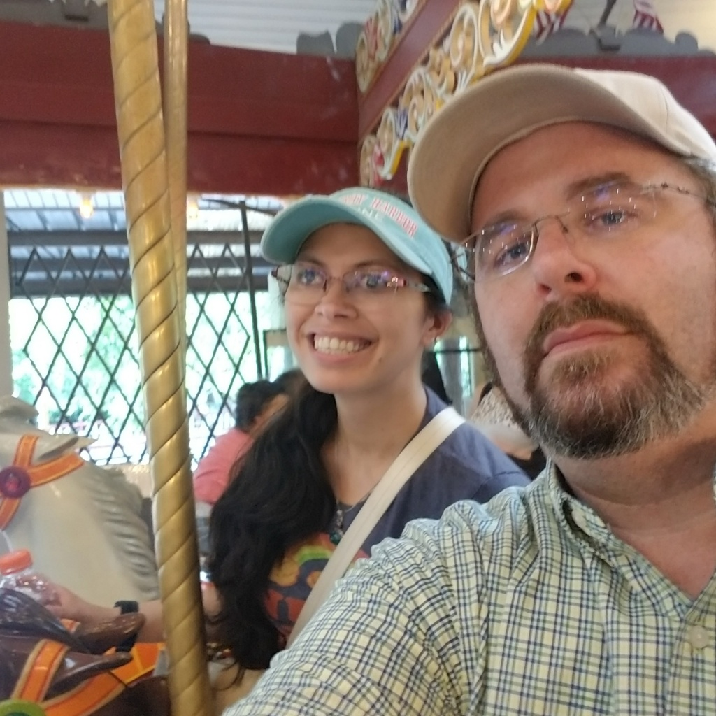 Jeff and beckie smile as they take a selfie on the carousel at Knoebels amusement park